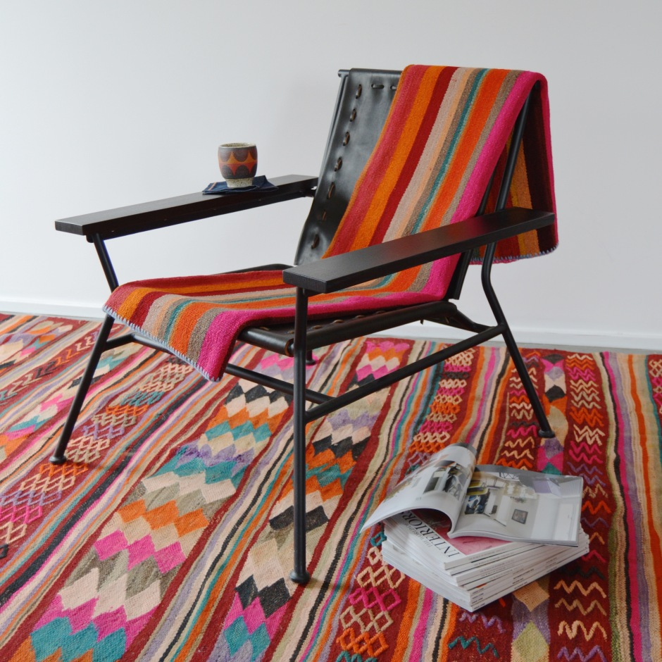 Garza Marfa Black Saddle Leather Armchair. Pictured with Kat & Roger Mug and Vintage Textiles. Photo Courtesy of Jamey Garza